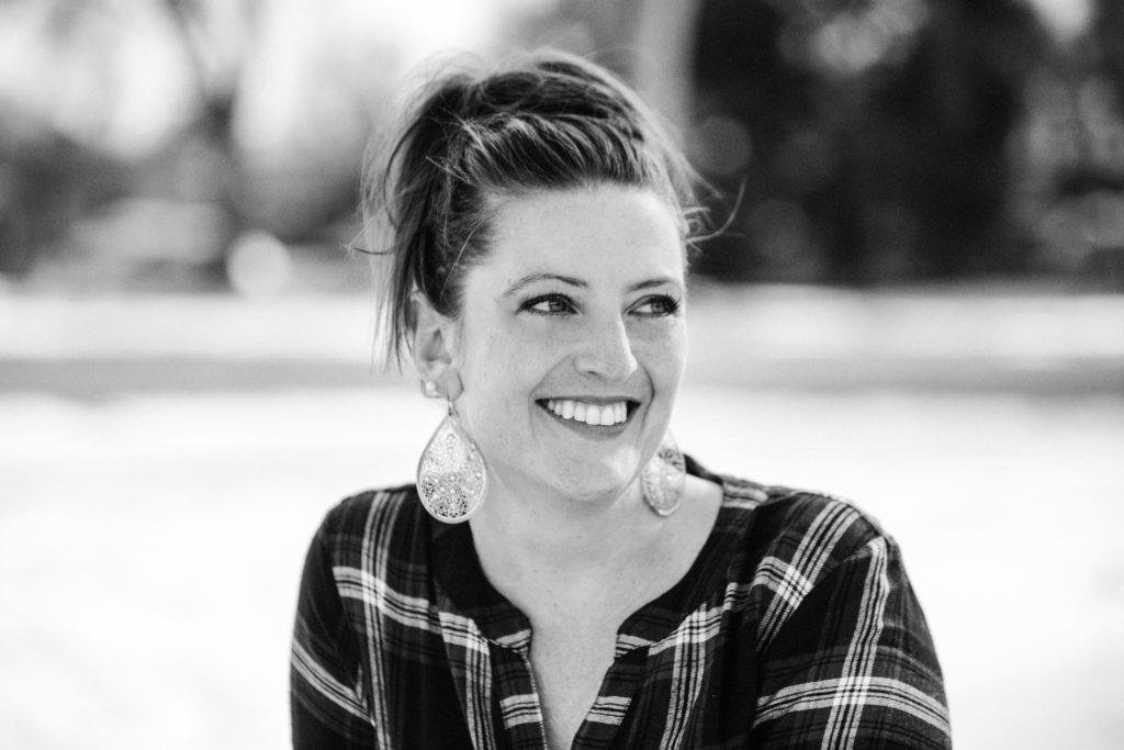 woman smiling with tear drop earrings