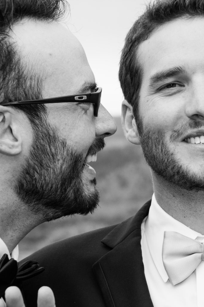 Groom with groomsman close to his face
