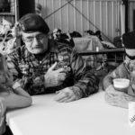 two war veterans talking to a little girl in fairy wings