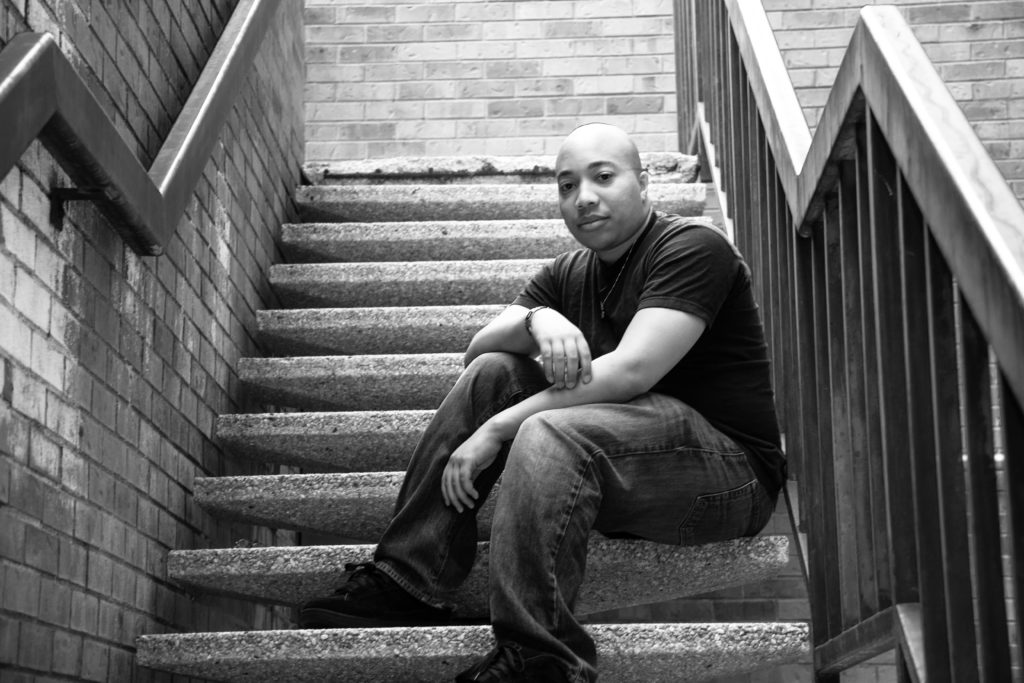 bald black man in stairwell