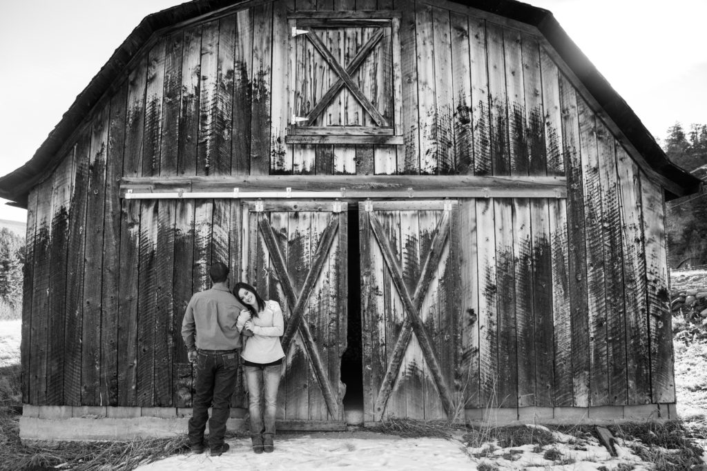Romantic couple in front of a barn
