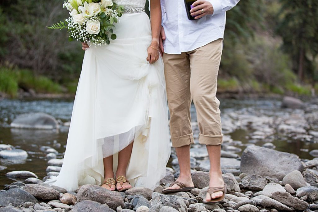 bride and groom feet in river
